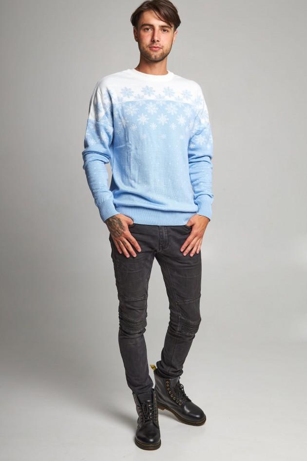 Новорічний в'язаний светр з зірками