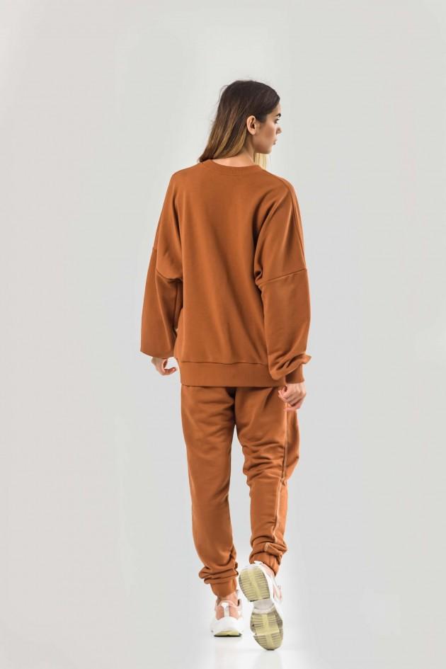 Костюм помаранчевого кольору